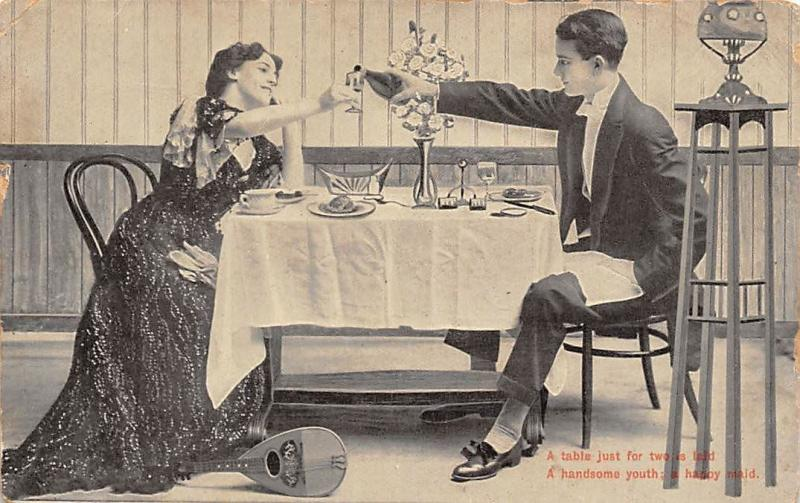 Table just for two handsome youth: happy maid, lovers, couple, dinner