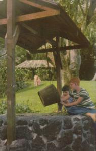 HAWAII, PU-1958; Waioli Grass House, children playing at a well