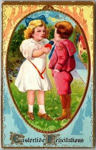 1911 EASTER Embossed Postcard Eastertide Felicitations Boy & Girl Colored Eggs