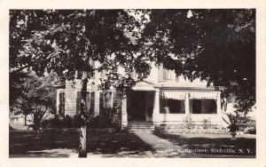 Richville NY H F Spooner Home~Owner on Porch~Roll-Up Awnings RPPC 1928 Postcard