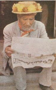Native Hawaiian reading a newspaper , Hawaii, 1940-60s