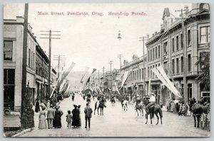 Pendleton Oregon~Main Street During Roundup Parade~Pennants, Hanging Light~c1910