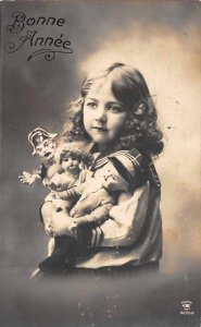 Bonne Anne New Year Greetings Girl with Dolls Real Photo Postcard JH231037
