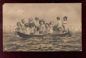 028358 MULTIPLE BABIES in Boat. Vintage PHOTO