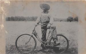 B31/ Bicycle Early c1910 Postcard Man on Bike Farmer Overalls