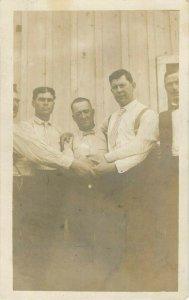 Postcard RPPC Men Shaking/Holding Hands