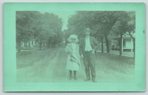 Oshkosh WI~Father Daughter in Big Hat~Residential Street Homes~Pennant~1910 RPPC