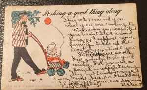 Vintage 1906 Pushing a Baby Greeting Postcard with stamp