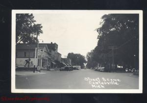 RPPC CENTERVILLE MICHIGAN DOWNTOWN STREET SCENE OLD CARS REAL PHOTO POSTCARD