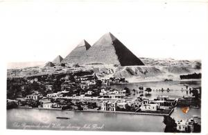Egypt, Egypte, Africa Pyramids and Village during Nile Hood  Pyramids and Vil...
