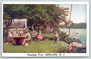 Ashland New Jersey Greetings~Family Outside at Tables~Kids on Stump~c1920 PC