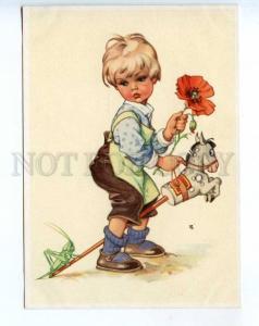 241635 HAUSEN CHILDREN Boy riding toy horse grasshopper poppy
