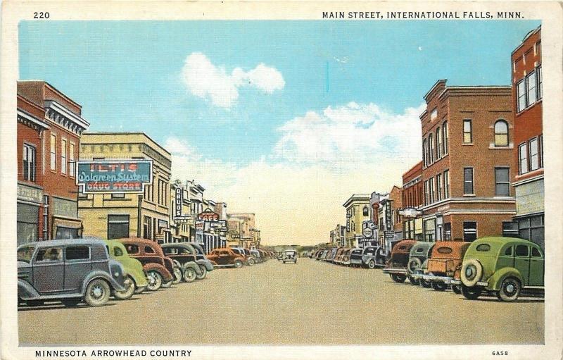 international falls mn iltis walgreens on main street 1940s postcard