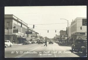 RPPC GRANTS PASS OREGON DOWNTOWN STREET SCENE OLD CARS REAL PHOTO POSTCARD