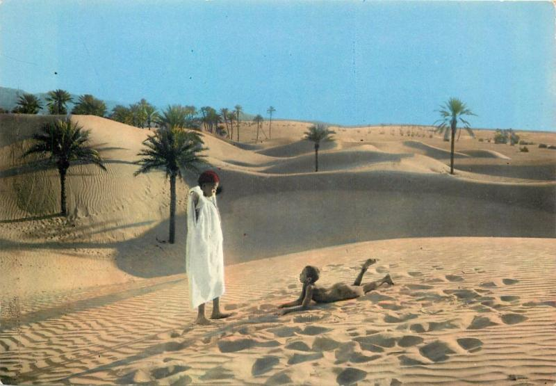 South Algeria ethnic children desert dunes palm trees