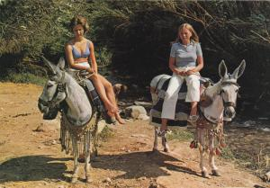 Mother and daughter riding donkeys, Spain , 50-70s