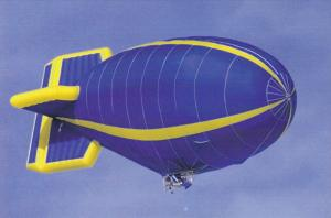 Blue and yellow Blimp in flight, 50-70s