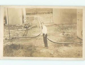 rppc Pre-1918 STANDING BESIDE MANY PIPES ATTACHED TO TANKS AC7776