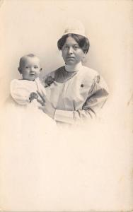 Nurse In Pinstripe Uniform Holds Baby~White Apron & Cap~Vignette~1915 RPPC