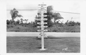 GUAM 1940s RPPC Real Photo Postcard Crossroads of the Pacific Signpost