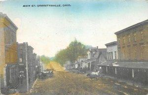 F53/ Garrettsville Ohio Postcard 1910 Main Street Wagons Stores Dirt