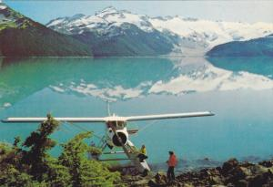 Float Airplane on Lake, Mountains Reflected in Lake, British Columbia, Canada...