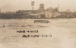 RP: COLUMBUS , Ohio , 1913 ; House floating in flood waters