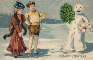 A Happy NEW YEAR; 1900-10s; Couple meets snowman carrying presents