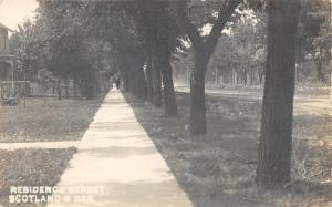 Scotland South Dakota~Residence Street (Unpaved)~Man on Walking~House~c1910 RPPC