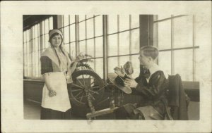 Young Man & Woman at Spinning Wheel - Costumes? c1910 Real Photo Postcard