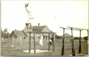Vintage 1910s RPPC Real Photo Postcard TURNERS Gymnastics / Man on Parallel Bars