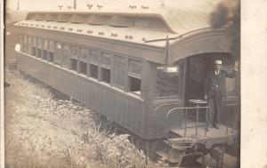 Extreme Closeup: RPPC ~Engineer Waves From Back of Long Caboose c1910 Postcard