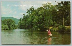 Rapid City Michigan~View Of Man Fishing On River~Vintage Postcard