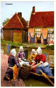Netherlands - Volendam. Women at Canal