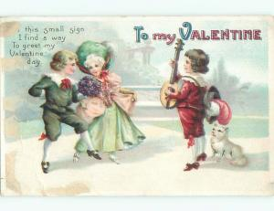 Pre-Linen valentine BOY PLAYS MANDOLIN MUSIC FOR DANCING COUPLE k5701