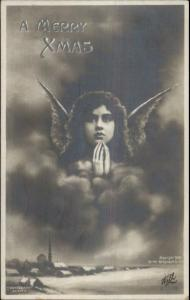 Christmas - Beautiful Angel Girl in Sky c1910 Real Photo Postcard