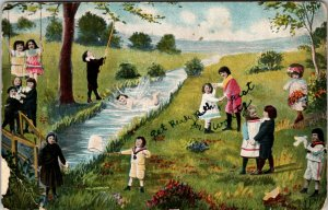 RARE  - LARGE GROUP OF BABIES & KIDS  PLAYING BY RIVER - ANTIQUE POSTCARD