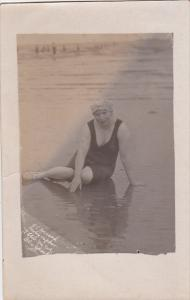 RP; Middle aged woman wearing bathng suit and cap on the beach, 10-20s