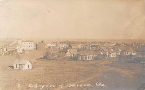 Drummond OK Birdseye~Square Homes~Man Outstanding in His Field~RPPC c1910
