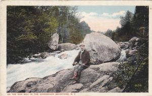 ADIRONDACK MOUNTAINS, NY, PU-1922; Man with shotgun, On the Run way in Mtns.