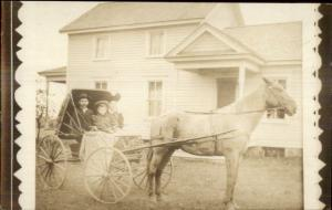 Family in Horse Drawn Wagon - Photo by E, Mouto of New London WI RPPC
