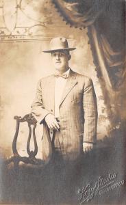 Sioux City IA~Kozy Studio Portrait~Man~Elbow on Chair~Pin Stripe Suit~1909 RPPC