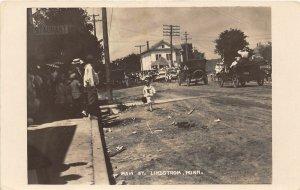 F80/ Lindstrom Minnesota RPPC Postcard 1915 Main Street Parade Autos