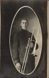 Young Man Uniform Posing Musicial Instrument Trombone Real Photo Postcard