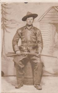 RP: Portrait of Cowboy with rifle , 00-10s ; Queen Studio , TORONTO , Ontario ,