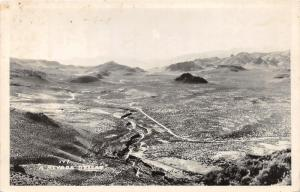 Nevada~Desert Scene~Hills Acorss Barren Land~1950s RPPC Real Photo Postcard