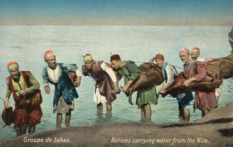 Egypt Natives carrying water from the Nile 01.53