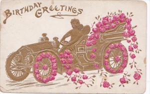 Birthday Greetings Cupid Driving Gold Car Decorated With Red Roses