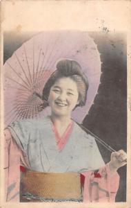 Geisha, under umbrella, traditional Japanese beauty