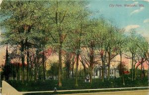 Waukesha Wisconsin~City Park~She Sits on Monument~Lots of Shade~1910 Postcard